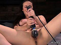 Brunette gets orgasm on anal fucking machine