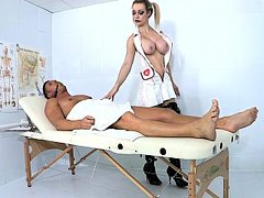 Pigtailed nurse blows a patient
